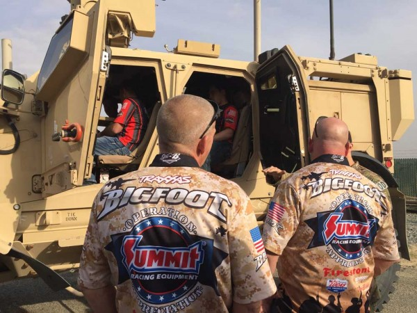 Dan Runte and Larry Swim check out the MAT-V, a military vehicle at Al Jaber Air Base in Kuwait.