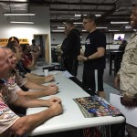 Dan and Larry meet soldiers off-duty at the recreation hall at Al Jaber Air Base in Kuwait.