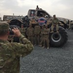 Troops snap a photo in front of the Summit Racing BIGFOOT 4x4 Monster Truck when it comes to visit the motorcade.