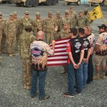 Summit Racing BIGFOOT 4x4 Monster Truck drivers Larry Swim and Dan Runte were joined by the Operation Appreciation team at the re-enlistment and promotion ceremony at the motorcade. Swim and Runte were honored to hold the American Flag behind the soldiers at the center of the ceremony.